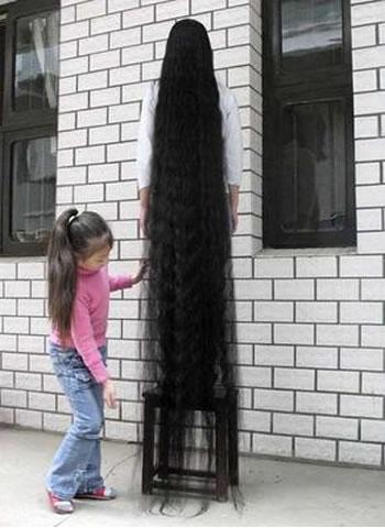 http://static.neatorama.com/images/2007-04/woman-long-hair.jpg