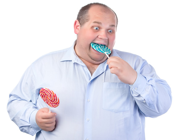 Fat man eating candies