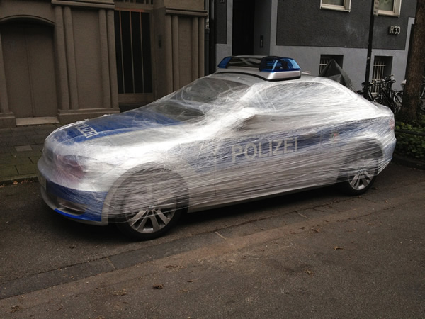 Police Car Wrapped In Plastic Art Or Vandalism Or Public