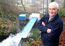 small waterwheel produces electricity