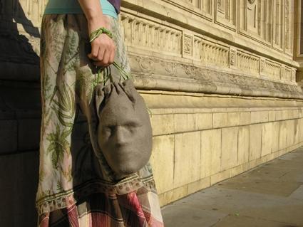Purse looks like it contains a human head