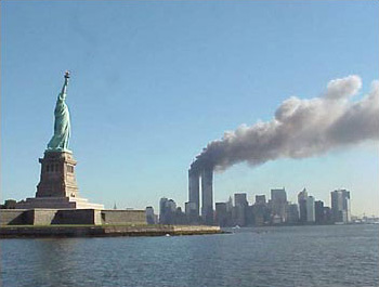 http://www.neatorama.com/wp-content/uploads/2009/12/National_Park_Service_9-11_Statue_of_Liberty_and_WTC_fire.jpg