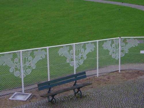 Lacy chain link fence art neatorama